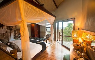 Rhino-Ridge-Safari-Lodge-Safari-Room-Interior-from-behind-bed-looking-out