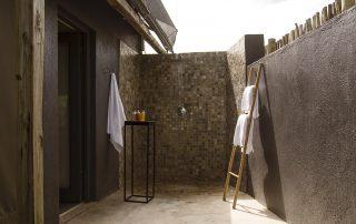 Simbavati-river-lodge-suite-outdoor-shower
