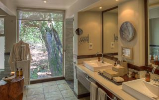 Bathroom-with-view-at-andBeyond-Phinda-Forest-Lodge