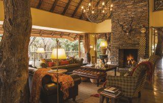 Tuningi-Safari-lodge-Xscape4u-Fire-place-and-cosy-lounge-Madikwe-Game-Reserve